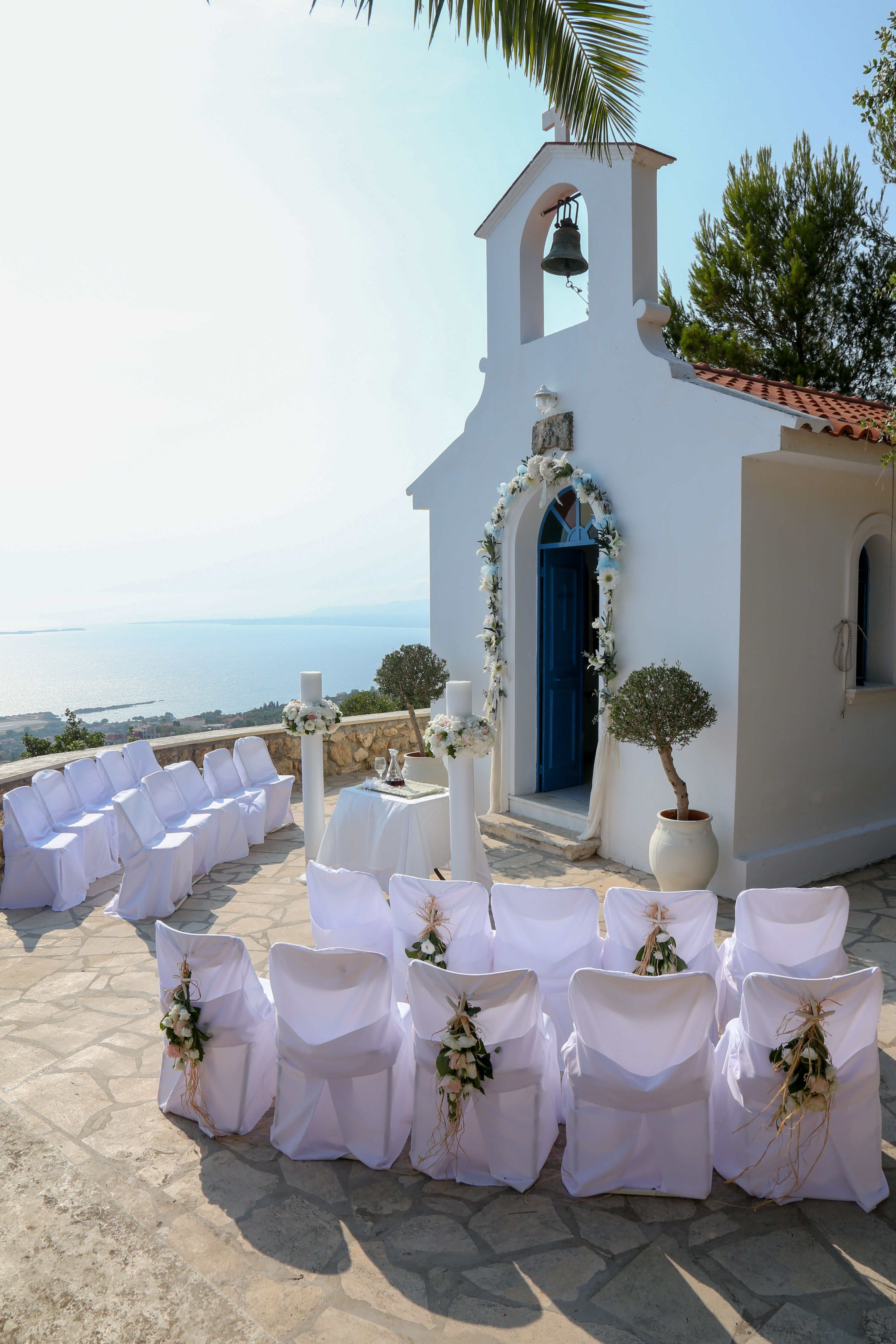 White-washed chapel with sea view Greek Wedding in ...