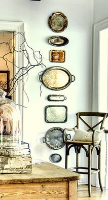 Photo of I love this idea of adding trays in a linear fashion to spruce up a wall in the dining area! This is such a cool and unique way to also show maybe some family heritage or hand-me-downs! Such a great unexpected element in a room!