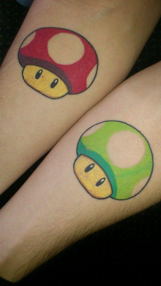 cute cartoon couple matching tattoo