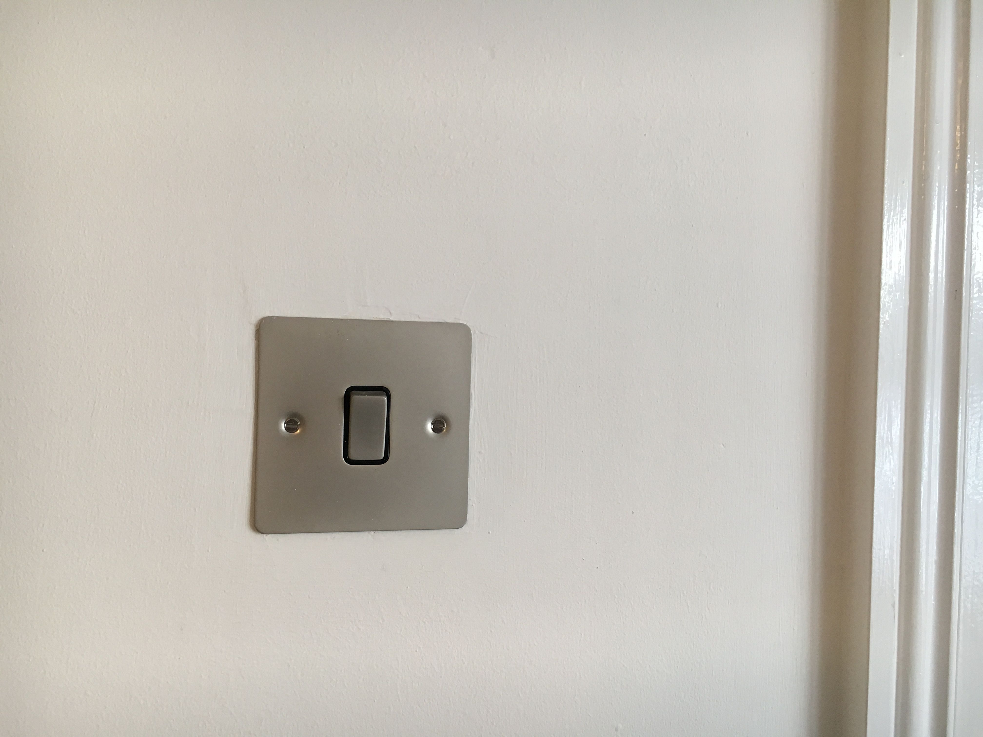 Chop out a deeper back box and install flush faced switch. Created a ...