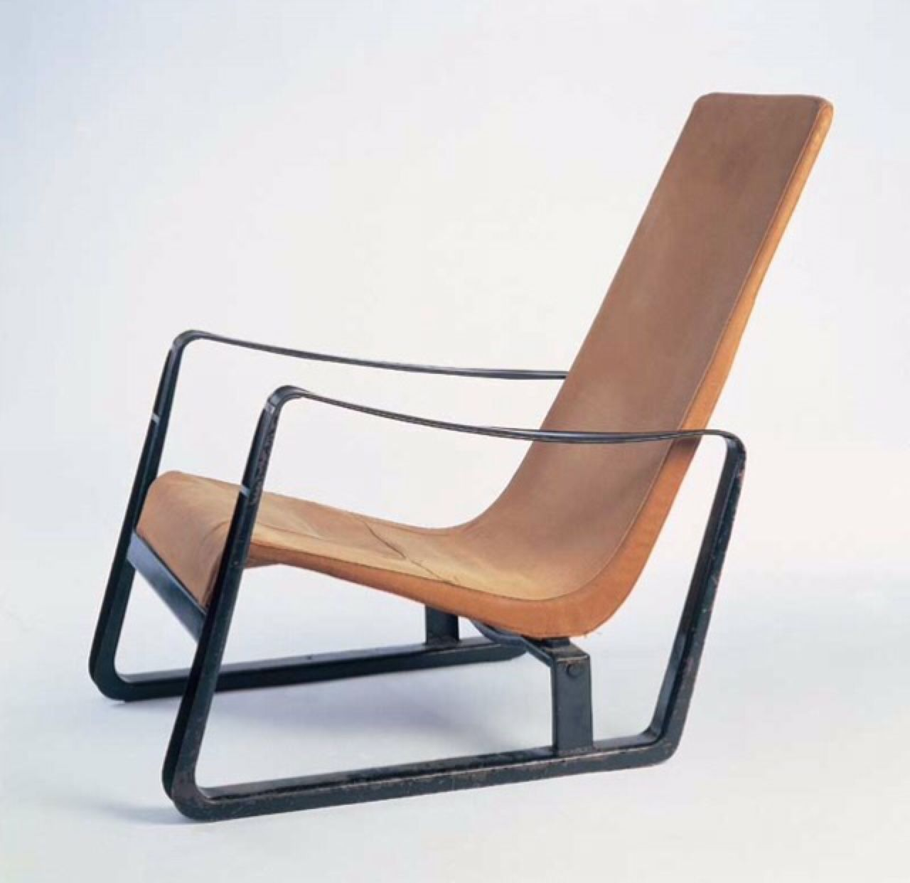 "redhousecanada: "" stillcollection: "" Cite arm chair "" The Cité Armchair (1930) exhibits a certain static dynamism inherent to Jean Prouvé's work with its low build and angled backrest. A resilient fabric sling seat is stretched over the chair's..."