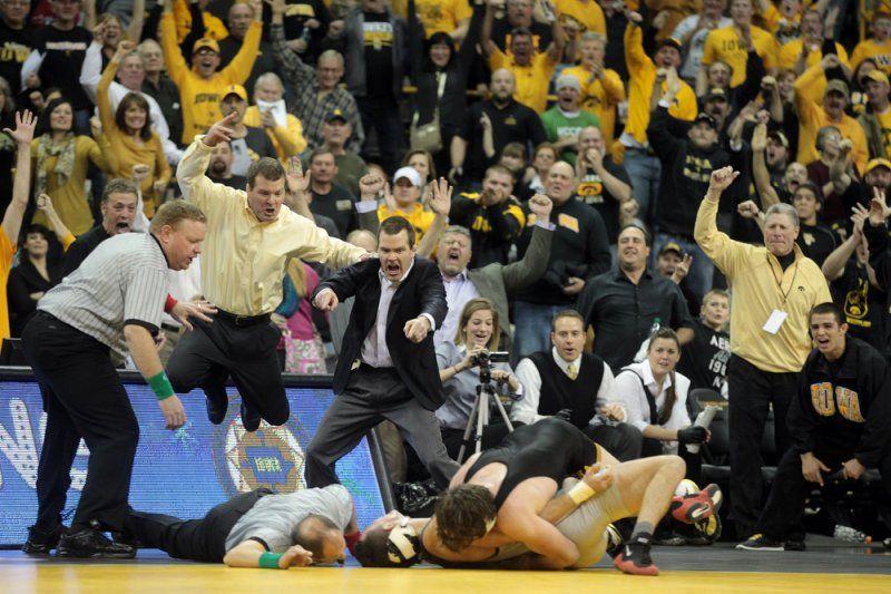 Iowa head coach Tom Brands, left, and associate head coach