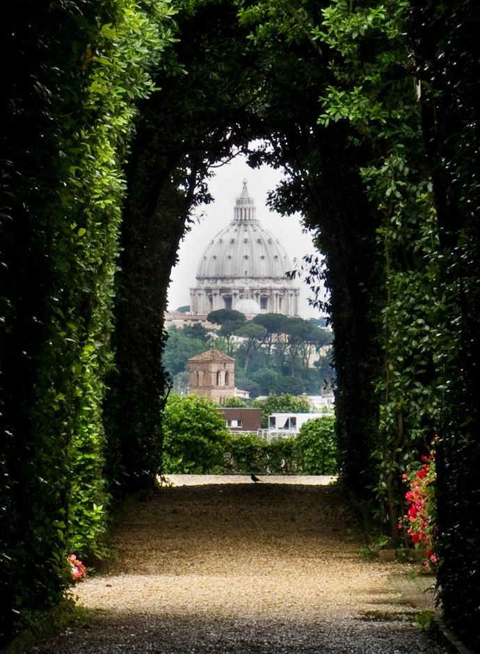 """Rome, Parco Savello - Most Romantic places in Italy - Rome's view is romantic enough, we know it, and pretty much every corner inspire's a love declaration. But how about strolling in Parco Savello on the Aventino hill. – also called Oranges' Garden – where you can admire the wide view on Italy's Capitol: San Pietro, the Altare delle Patria… only few steps away you'll find a maze of hedges that perfectly frame the """"er cupolone"""", the Dome of San Pietro."""