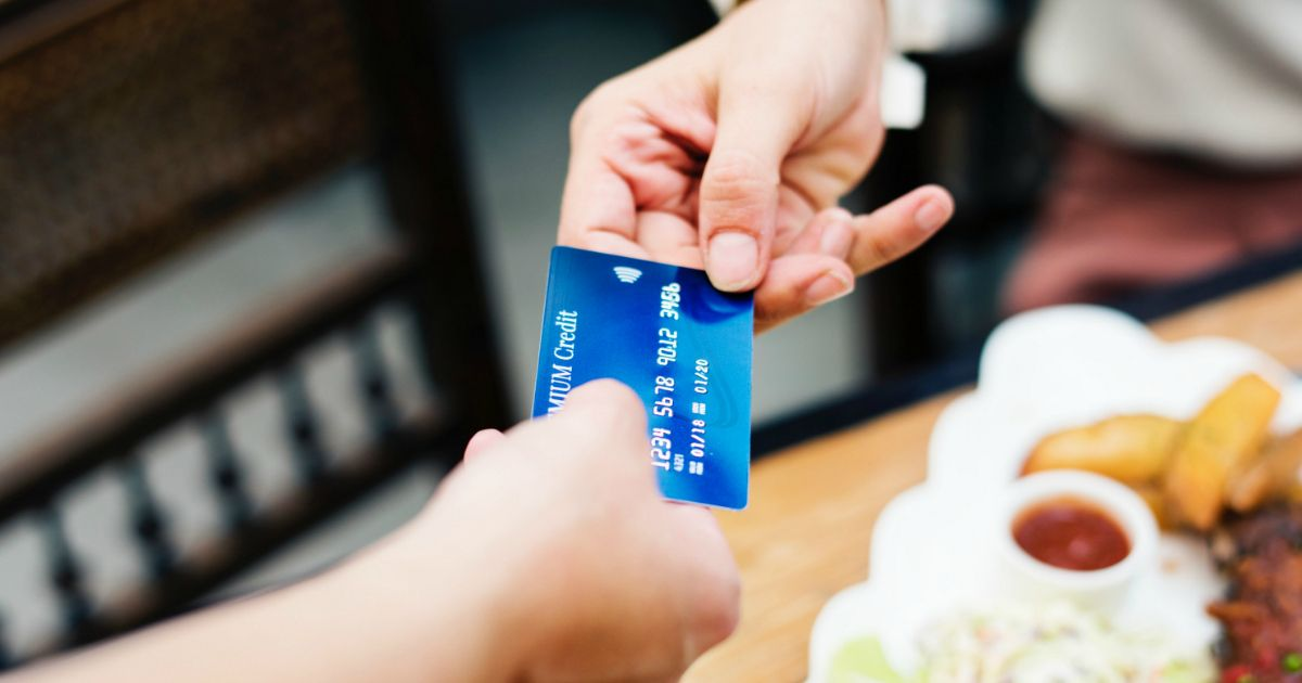 A New Law Provides Free Credit Freezes And Protection One Person Handing A Credit Card To Another Credit Card Processing Best Credit Cards Credit Repair