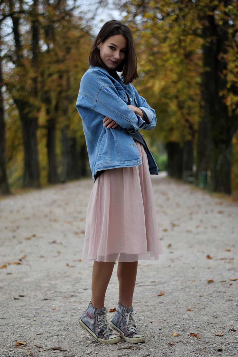 c834c4af711 Pastel pink ballet tulle midi skirt with a denim jacket and a pair of  sneakers. Fashion blogger outfit inspiration.