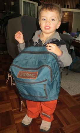 This was an upcycling project.  Found an adult backpack at the thrift store, bought it for a buck and transformed it into the coolest toddler backpack ever.  This was a fun challenge! Isaac loves it!