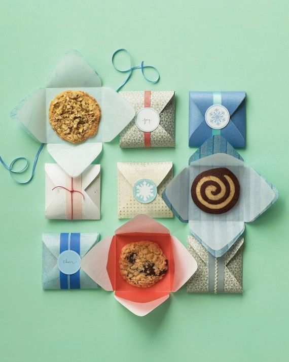 Here's a clever way to wrap cookie favors: Line easy-to-make paper envelopes with waxed tissue, and seal with punched-paper labels.Print the Single-Serving Sweets Packaging Template and the Snowflake Clip Art