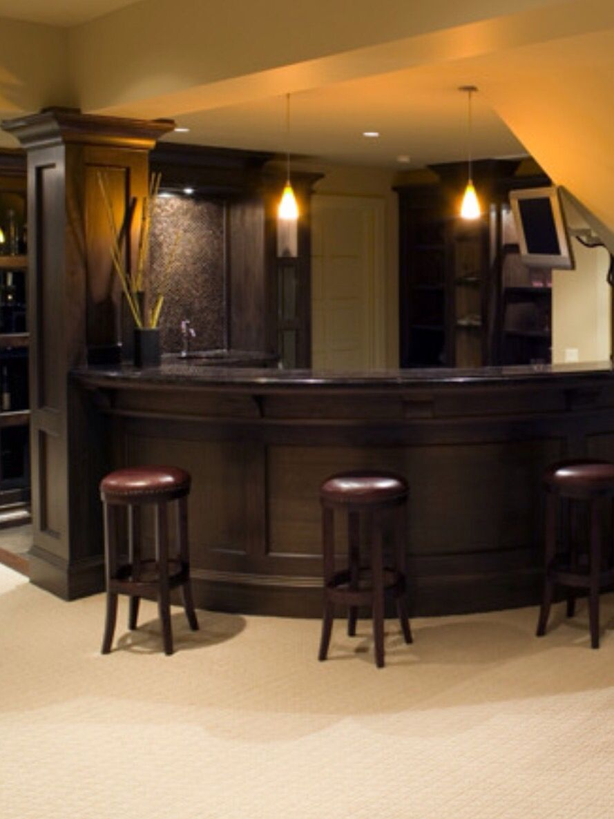 side cabinet storage and door behind the bar family room rh pinterest com