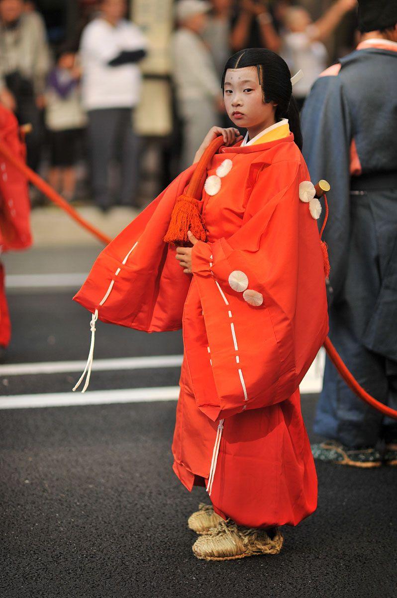 A little maid attending to the ceremonial ox cart - Jidai Matsuri Festival, Kyoto