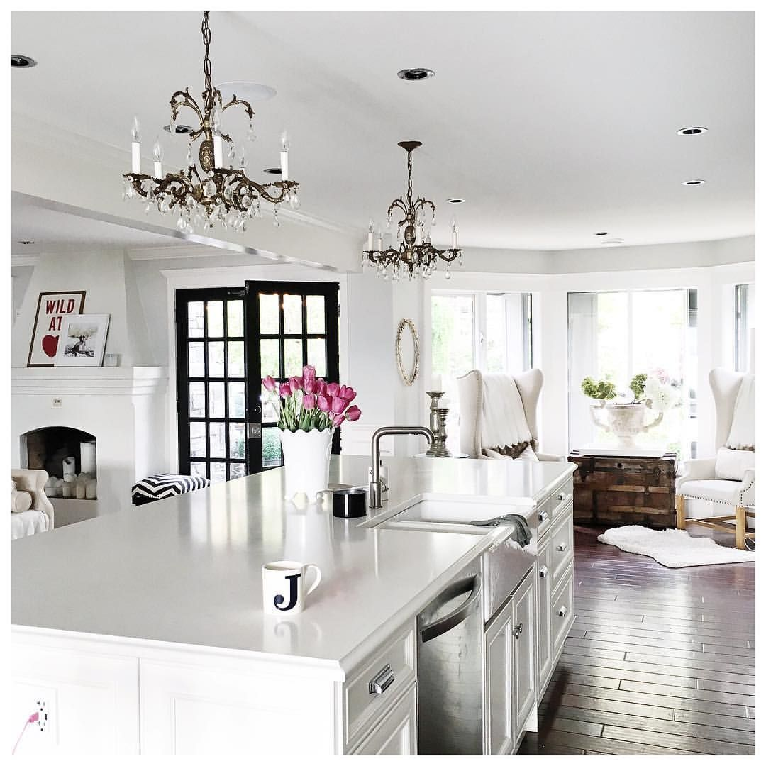 All white kitchen with misty carrera caeserstone for Jillian harris kitchen designs