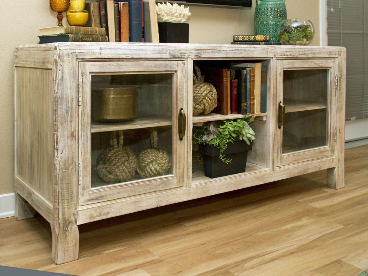 Check out a neutral wood cottage style credenza with glass doors ...