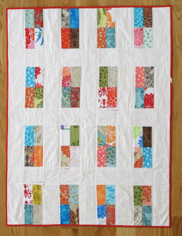 This quilt will make for a fun and interesting short project for any level of quilter.  The design comes to us from Anna of Six White Horses.  To learn how to make this quilt, find the tutorial at http://www.freequiltpatterns.info/free-tutorial---bright-windows-baby-quilt.htm