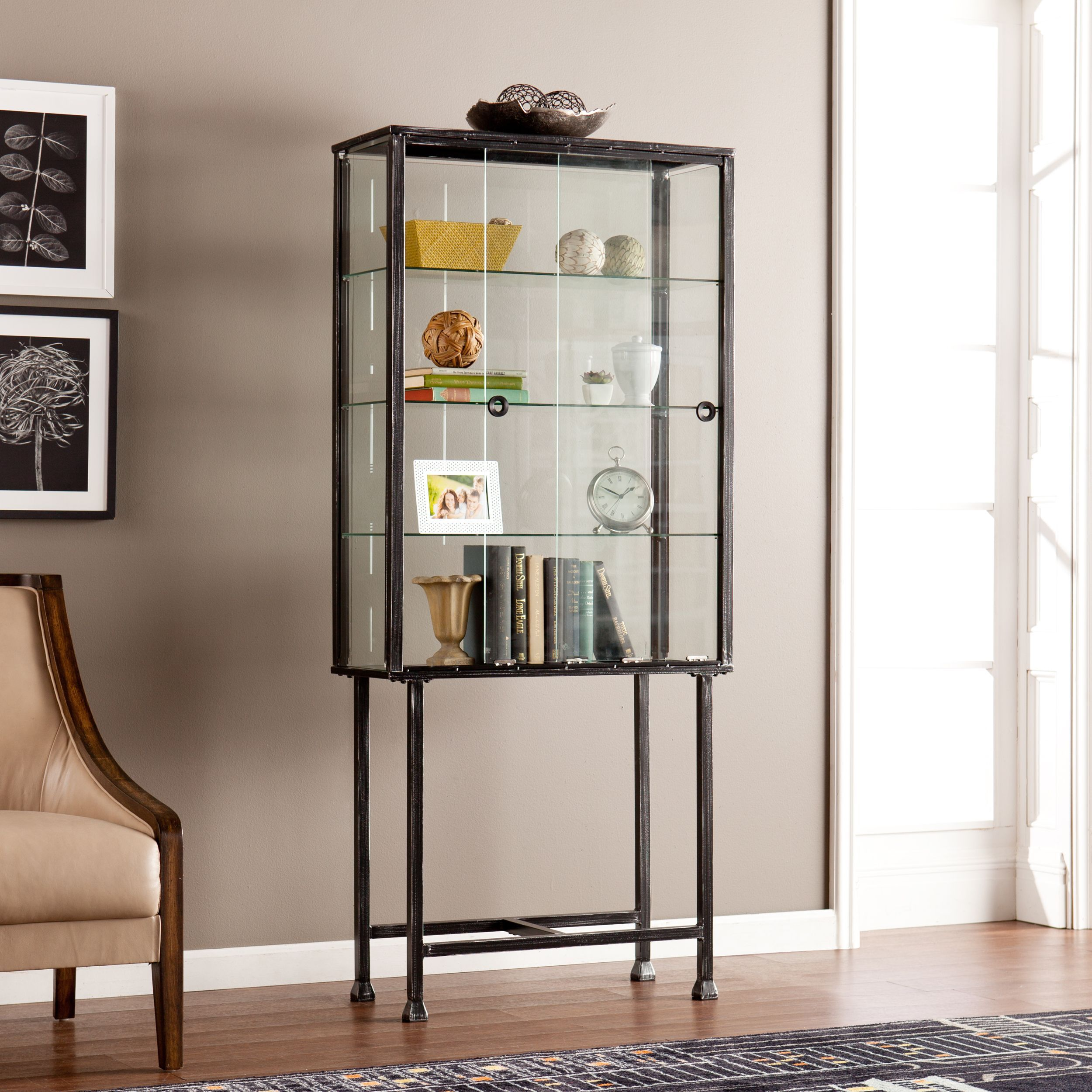 This Upton Home Sliding Door Cabinet Features Four Shelves For