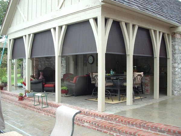 Outdoor living room with rollertube drop shades to enclose for Outdoor enclosed patio ideas