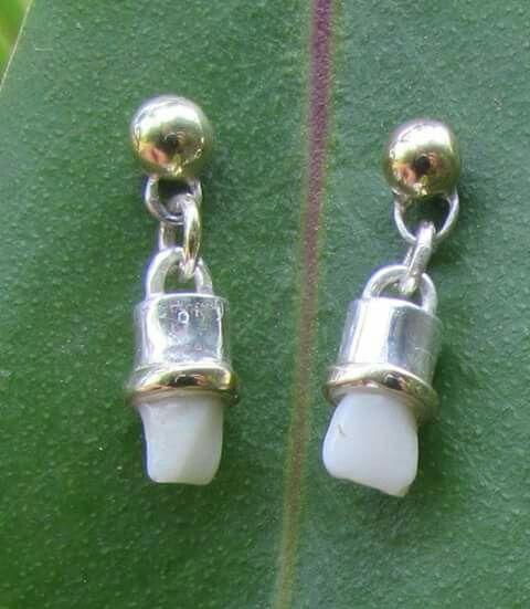 c62f592cd10a Aretes de oro plata con dientes engastados .