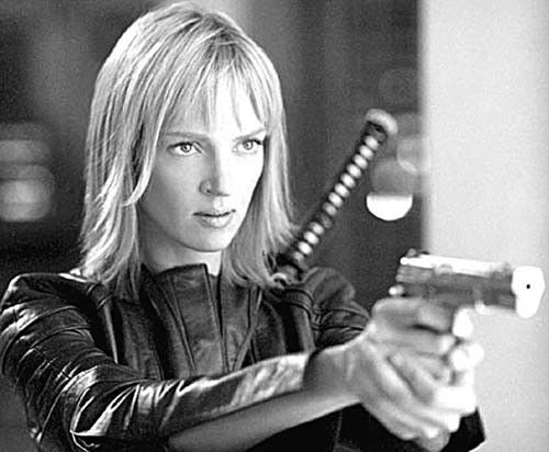 Uma Thurman as 'The Bride in Kill Bill' is arguably the all-time best 'action-heroine' . She has many admirers : ''Uma Thurman stands 6-feet tall , and it wasn't long before she smartly dumped her midget husband Ethan Hawke''.