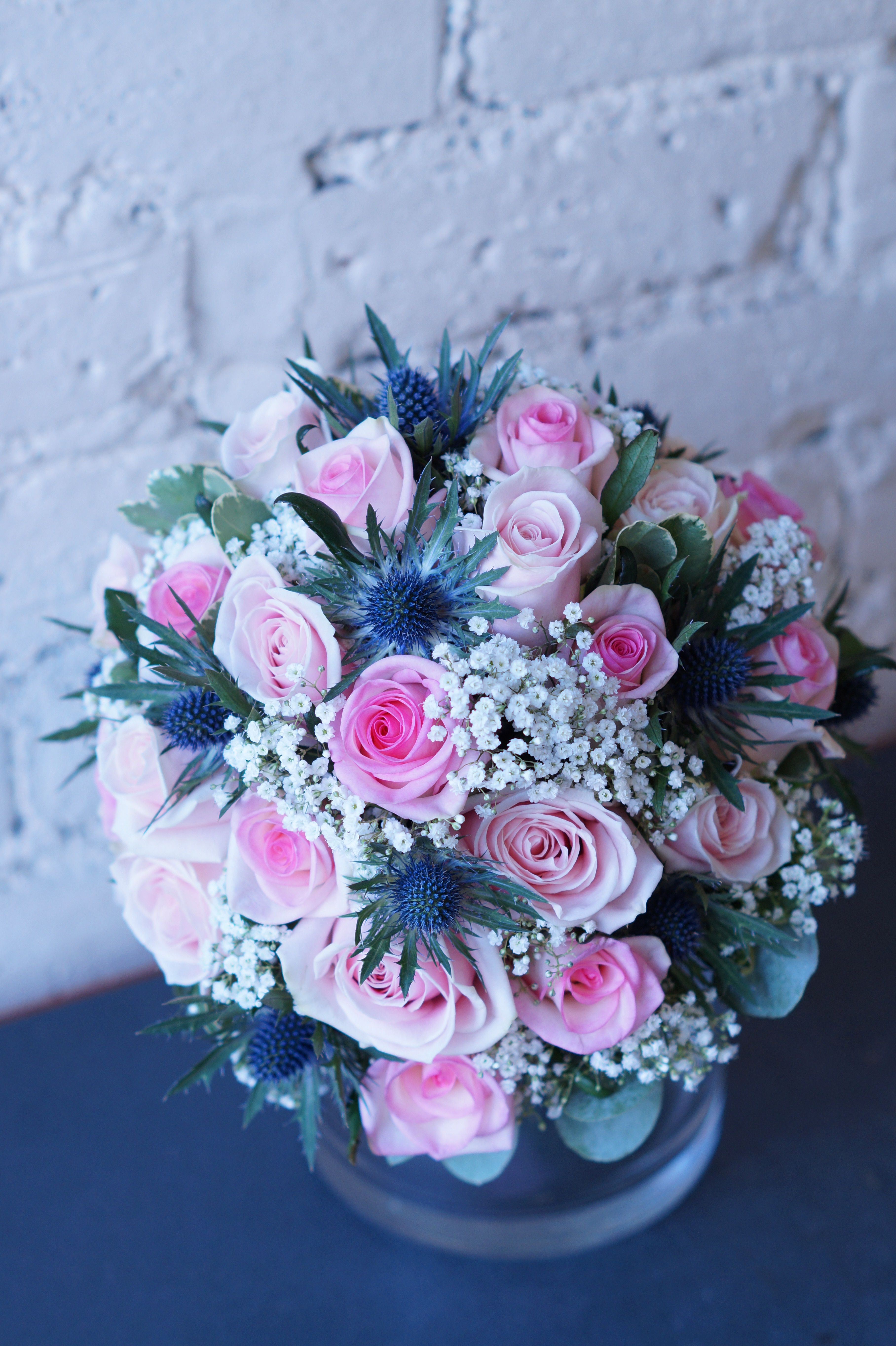 This bouquet was a mixture of soft pinks blue and white shades the this bouquet was a mixture of soft pinks blue and white shades the blue flower are called eryngium the white flowers are gypsophila and avalanche roses izmirmasajfo