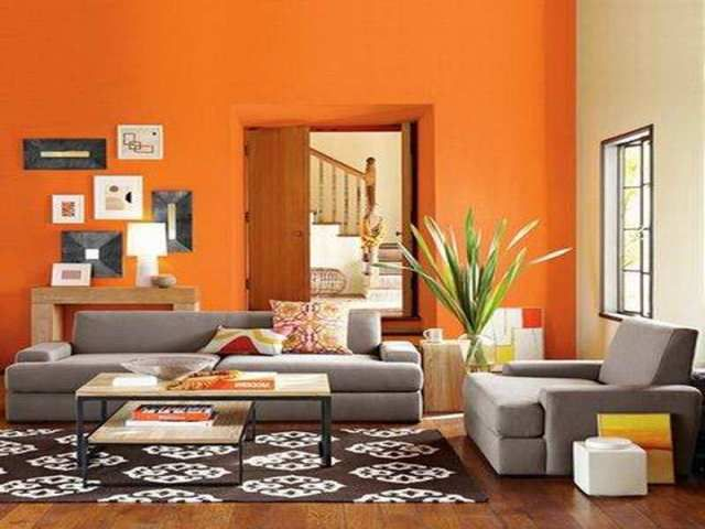 accent wall in living room dark gray fireplace accent couches with grayorange - Warm Wall Colors For Living Rooms