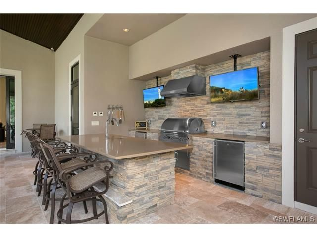 Outdoor Bar Kitchen Counter Seating Two Tvs Mediterra Naples Fl Outdoor Kitchen Bars Outdoor Kitchen Outdoor Rooms