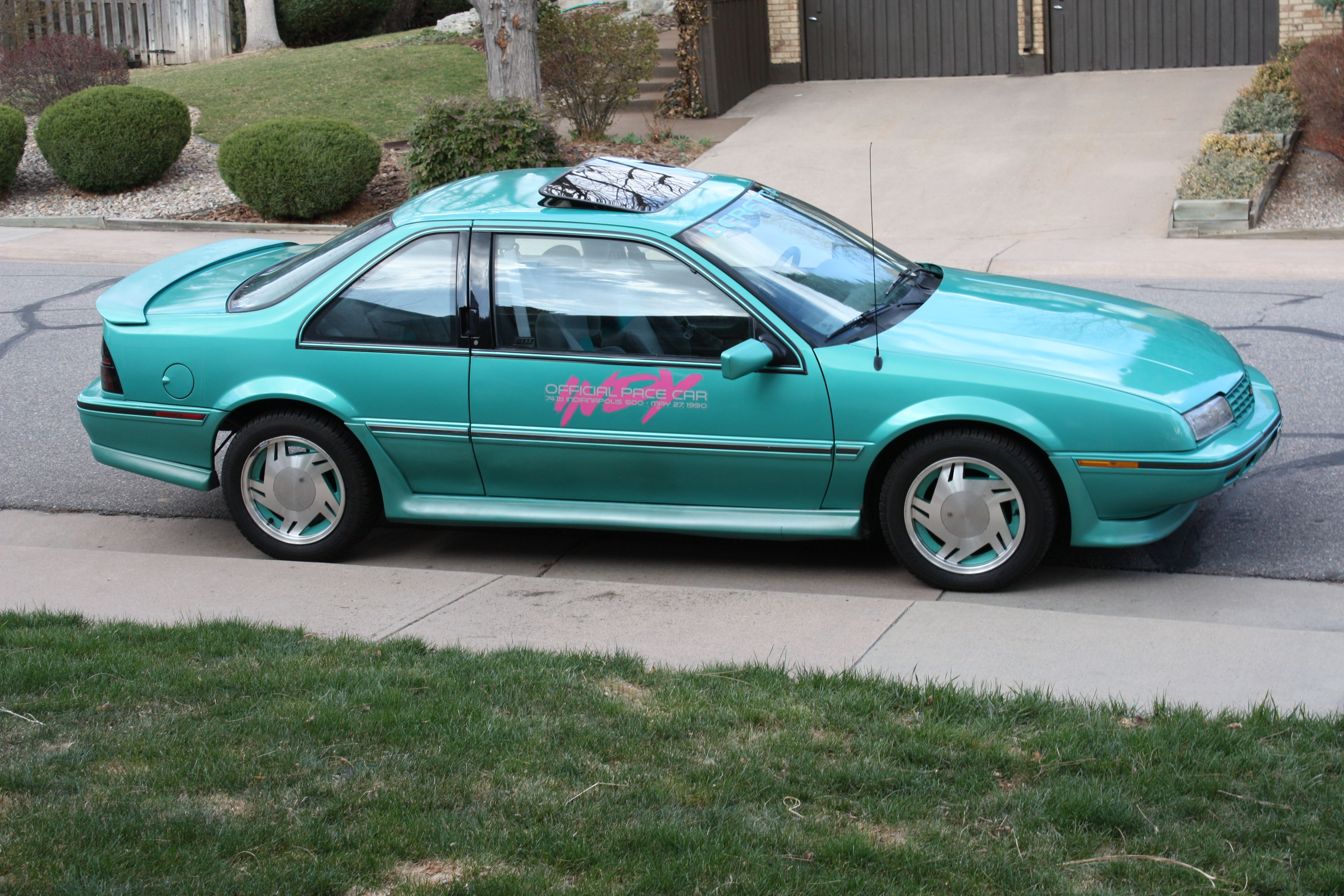 These cars received color-coordinated alloy wheels, Indy 500 decals ...