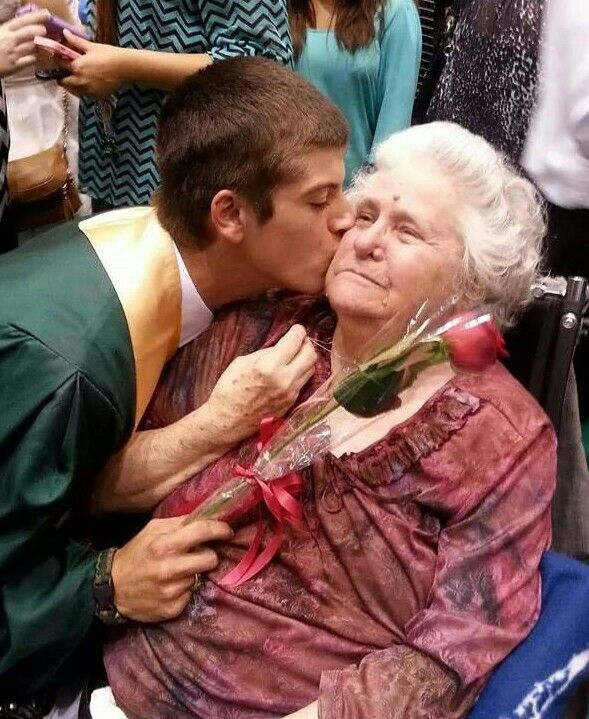 A kiss and a rose for grandma.