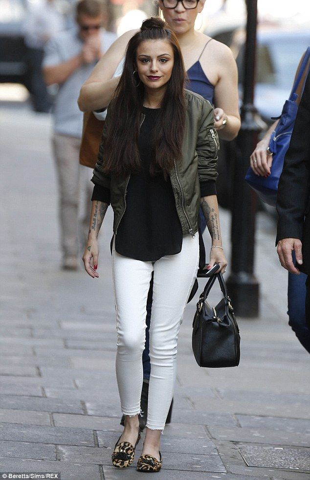 Cher Lloyd cuts stylish figure in white jeans and khaki sports ...