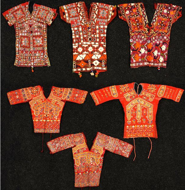 India, embroidered and mirrored choli blouses, back tying blouses with colorful embroidery and couched mica disks, 20th c.