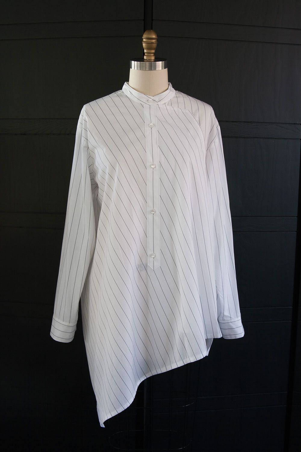 Modern seaming and angle play. Bright white cotton shirting with ...