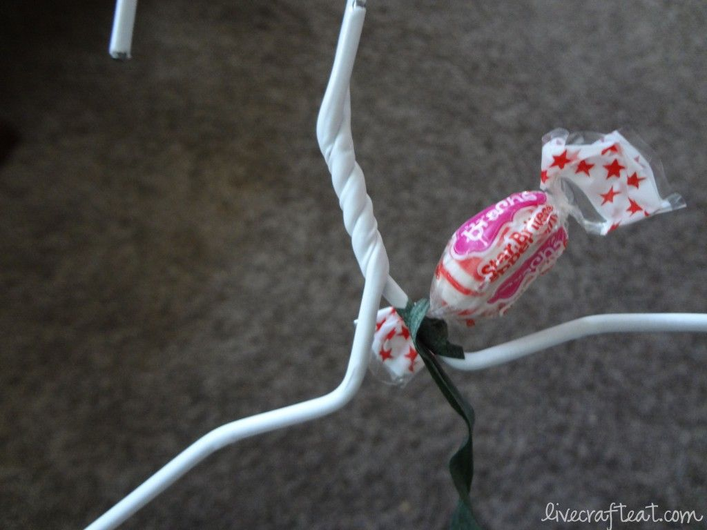 How To Make A Candy Wreath Craft For Christmas | Wire hangers, Candy ...
