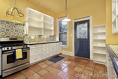 kitchen in suburban home with terra cotta floor tile | kitchen