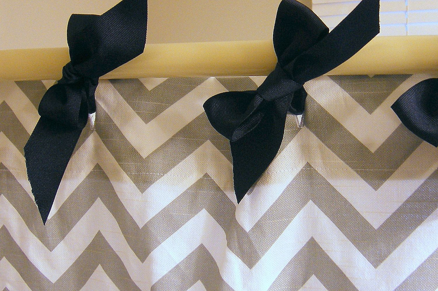 Use ribbon to tie shower curtain onto rod.  So cute! This would be cute for curtains too!