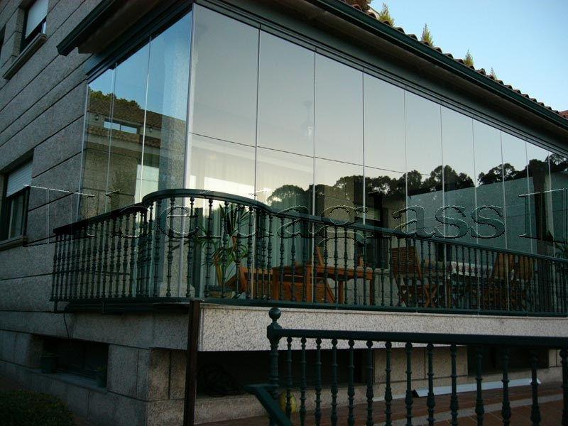 Cerramiento de balcon con cortinas de cristal for Cortinas para cristales