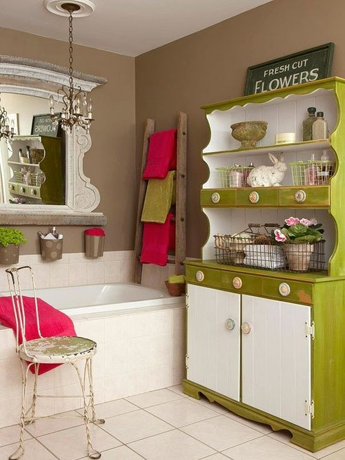 re-purposed kitchen hutch in bathroom.  Like the ladder for bath towels also.