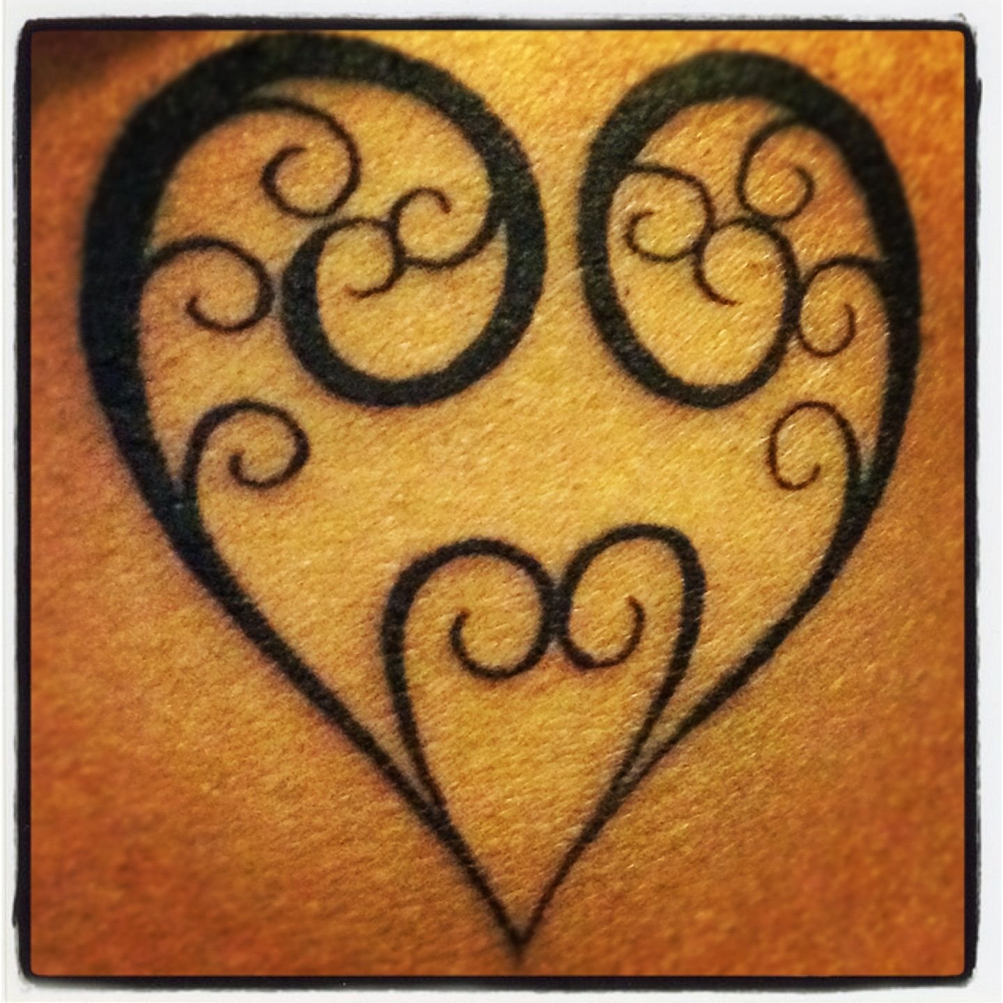 New tattoo on my ribcage :) Fern fronds heart by Dylan at Tattoo City in Wellington, NZ.