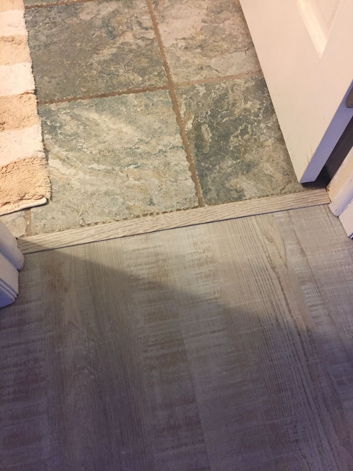 where lvt meets ceramic edging used was a baby threshold  top  - edging used was a baby threshold