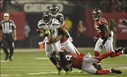 Gimpy Marshawn Lynch struggles in loss to Falcons