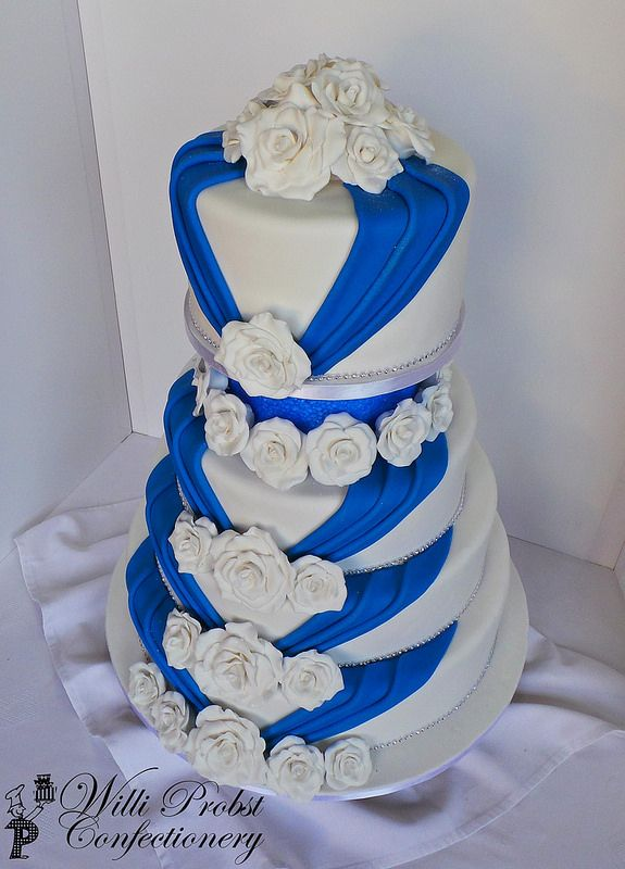 4 Tier White Royal Blue Wedding Cake Royal Blue Wedding Cakes Wedding Cakes Blue Royal Blue Wedding