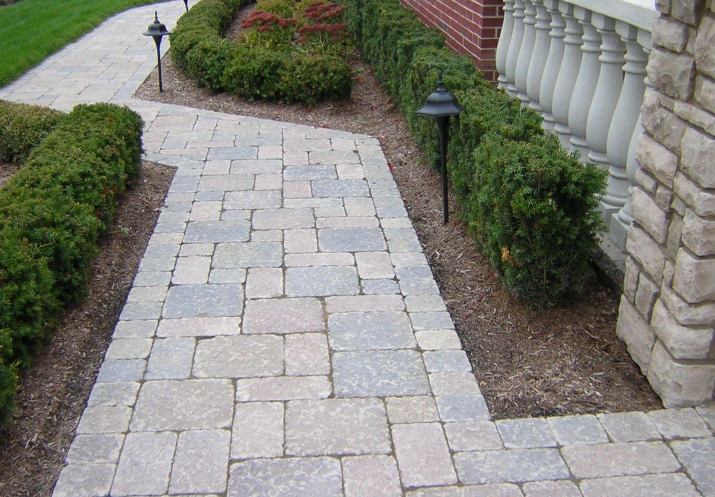 Stone walkway designs for homes with green lush plants and green ...