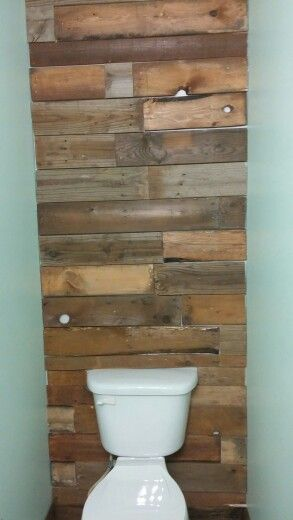 pallet wall behind toilet