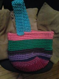 I crochet leftovers yarns and it turned out to be a neato bag.