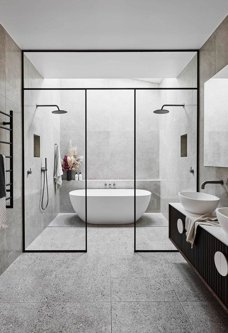 Bathroom: A generous master bathroom features a freestanding bathtub, twin showe…