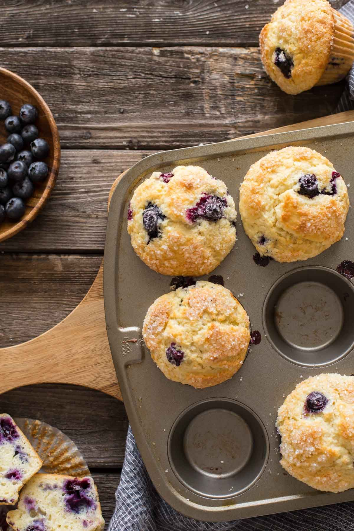 Best Ever Buttermilk Blueberry Muffins In A Muffin Pan On A Wooden Backboard With A Bowl Blue Berry Muffins Buttermilk Blueberry Muffins Best Blueberry Muffins