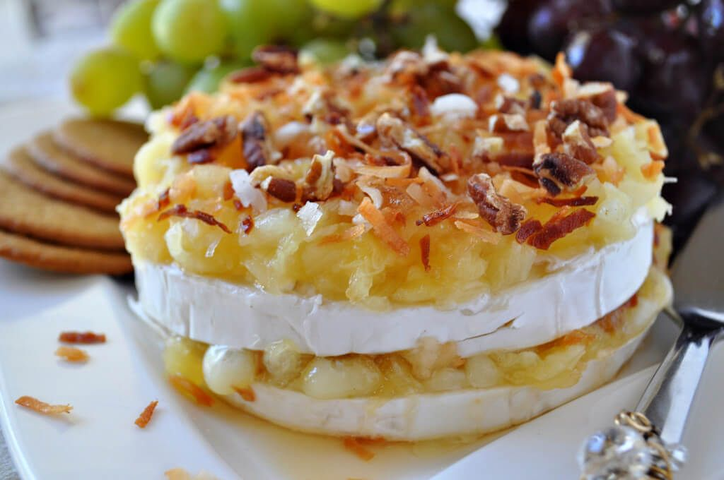 Pineapple, coconut & brown sugar turn favorite tropical drink into best of Brie appetizer recipes. Melt in your mouth Pina Coloda simple baked Brie