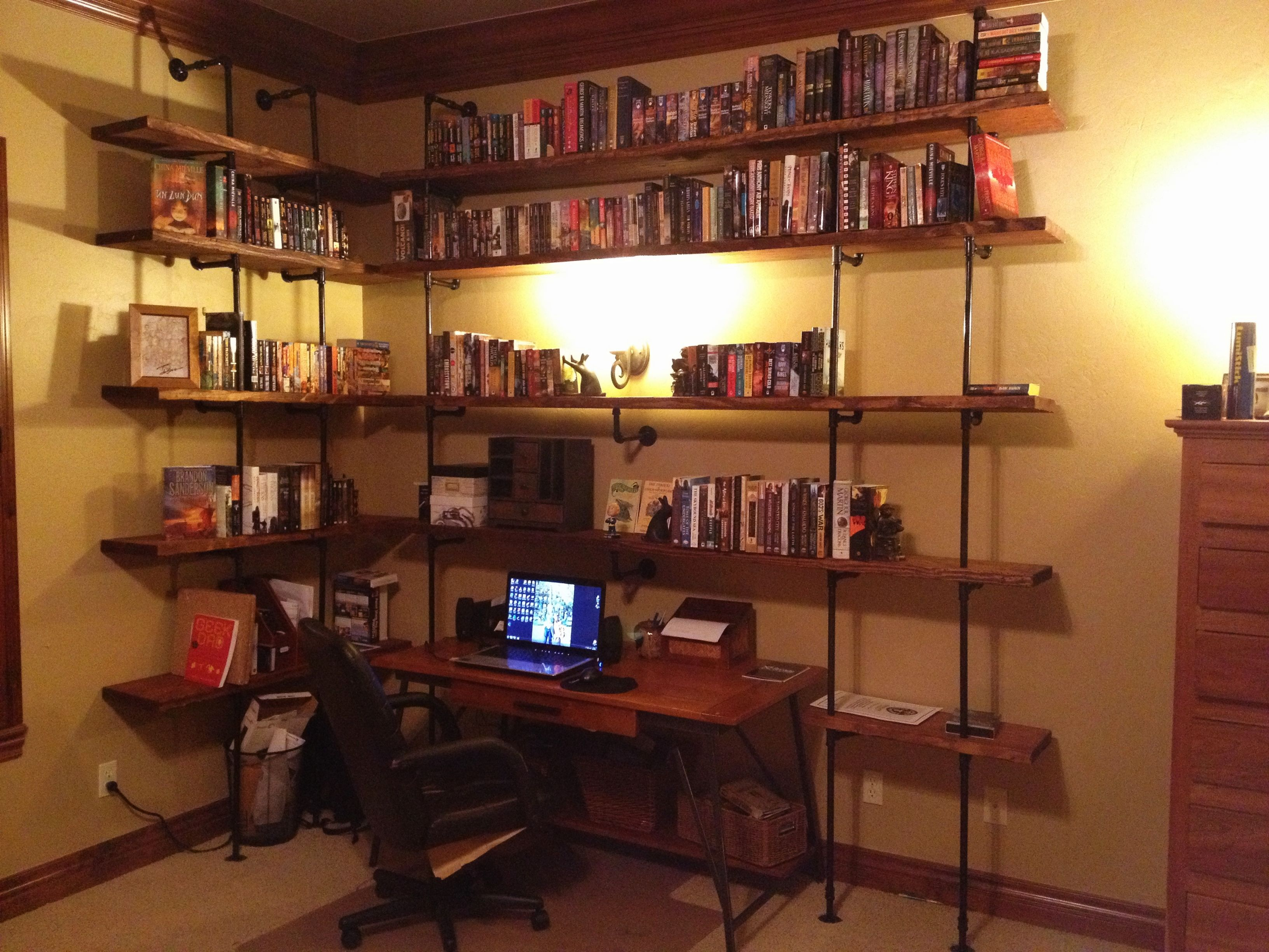 Pvc Pipe Bookshelf Pipe Bookshelves Built Around A Desk Uses Inexpensive 2x12 Boards