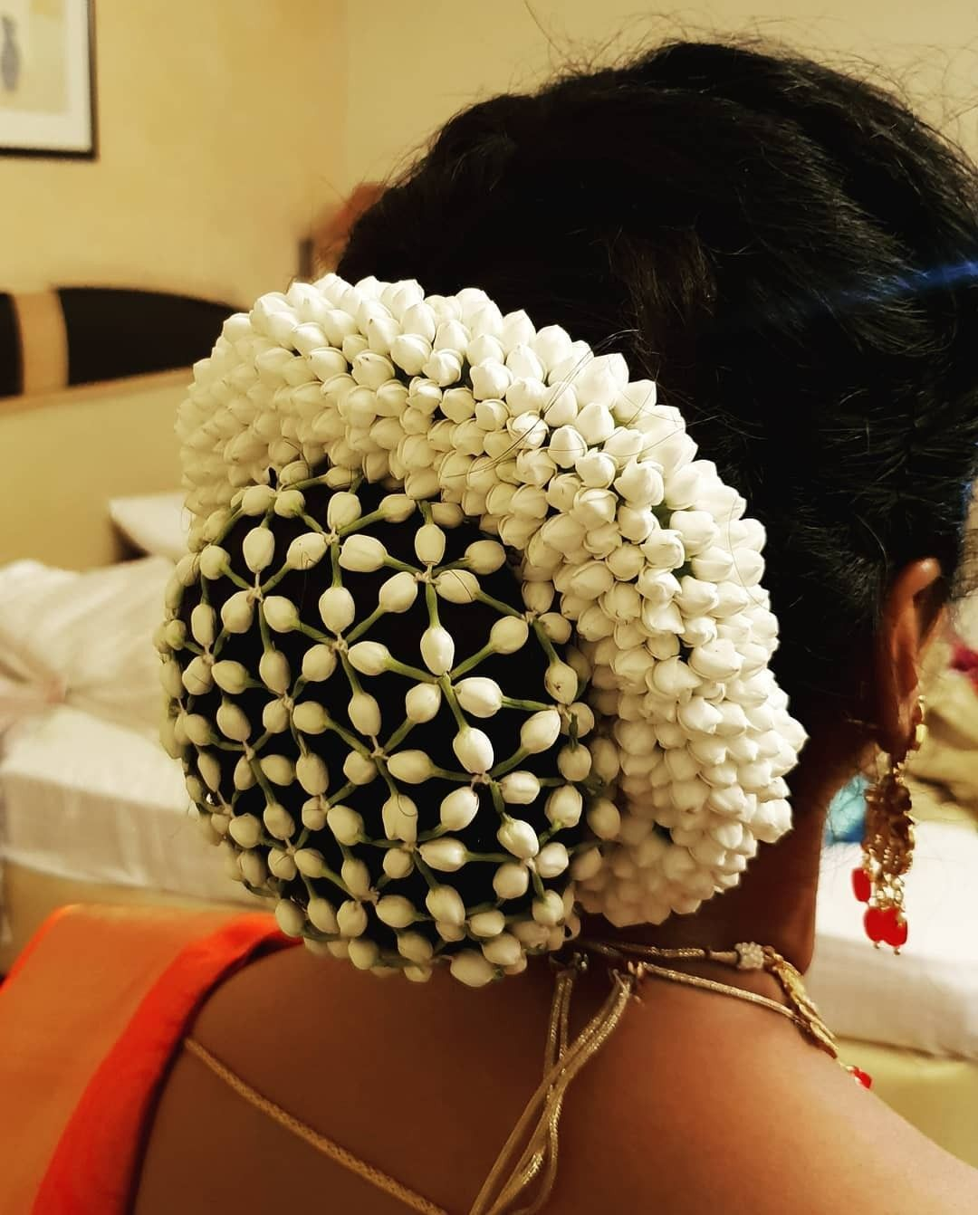 What A Beautiful Large Low Bun With Real Flower Gajra Mesh Cover Care However Should Be Taken Befor Bridal Hair Buns Bun Hairstyles Indian Bridal Hairstyles