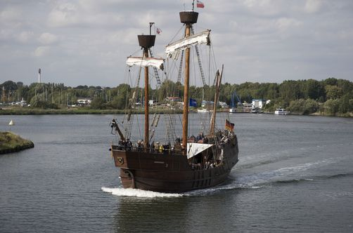 Replica of a karvel sailing on Trave river Lubeck, Germany