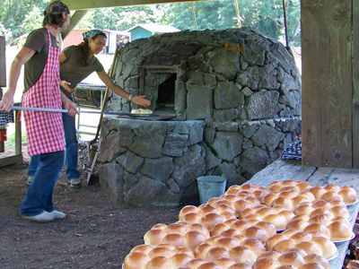 PORTUGUESE STONE OVEN BAKING  — Kona Historical Society. They practice the traditional art of baking Portuguese bread in a large wood-fired forno. Join them Thursdays from about 10am-1pm to talk story, roll dough & bake it in a communal oven that holds > 30 loaves of bread. The 1st loaves of beautiful brown bread are done between 12-12:30 pm & sold for $7 straight from the oven or from their roadside table until 3pm or until they are gone (1st come, 1st served). The recipe is available…