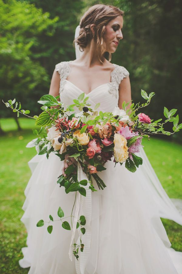 organic bouquet shape, photo by Teale Photography http://ruffledblog.com/elegant-rainy-day-wedding #weddingbouquet #flowers