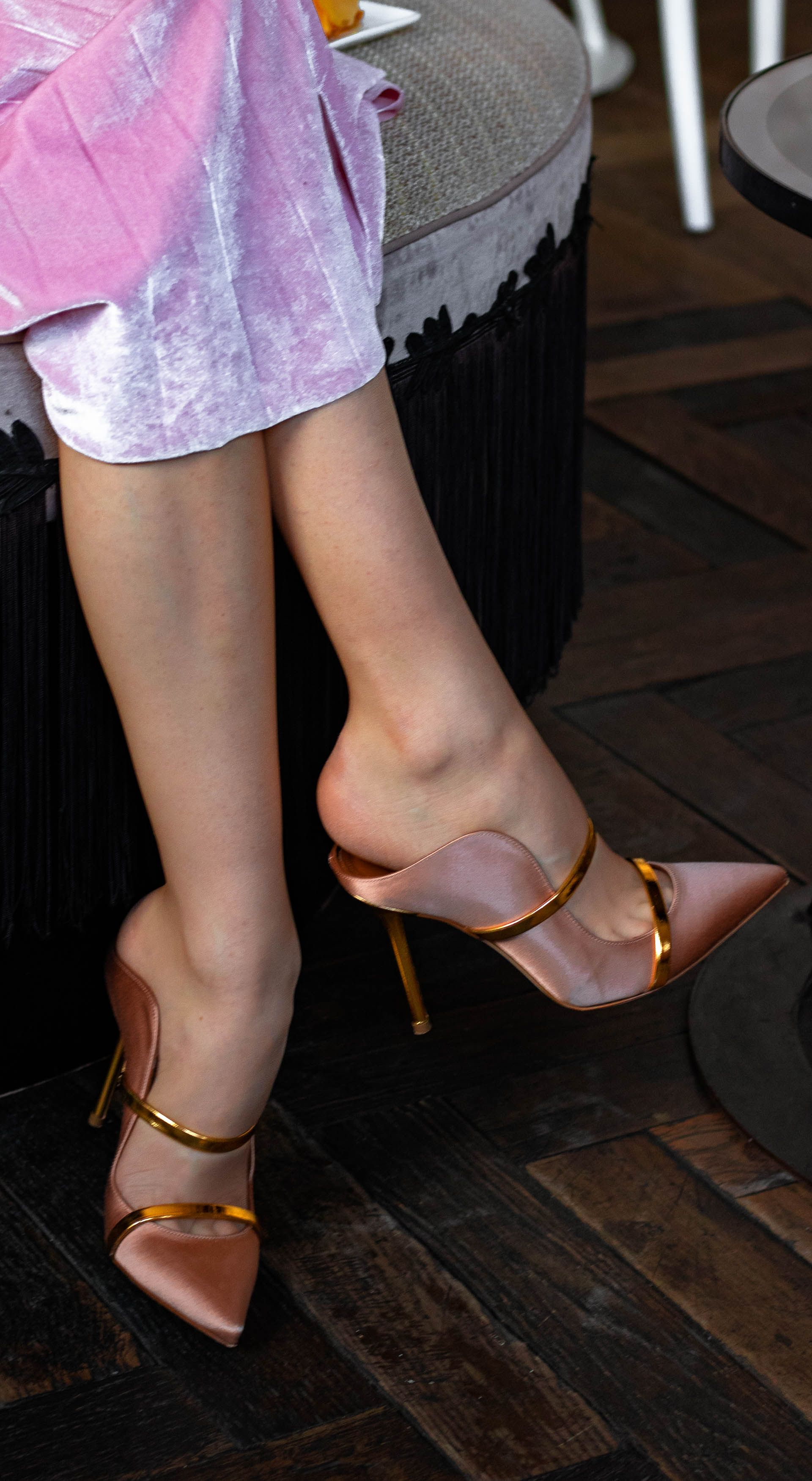 Brunette from Wall Street rose gold Malone Souliers mules