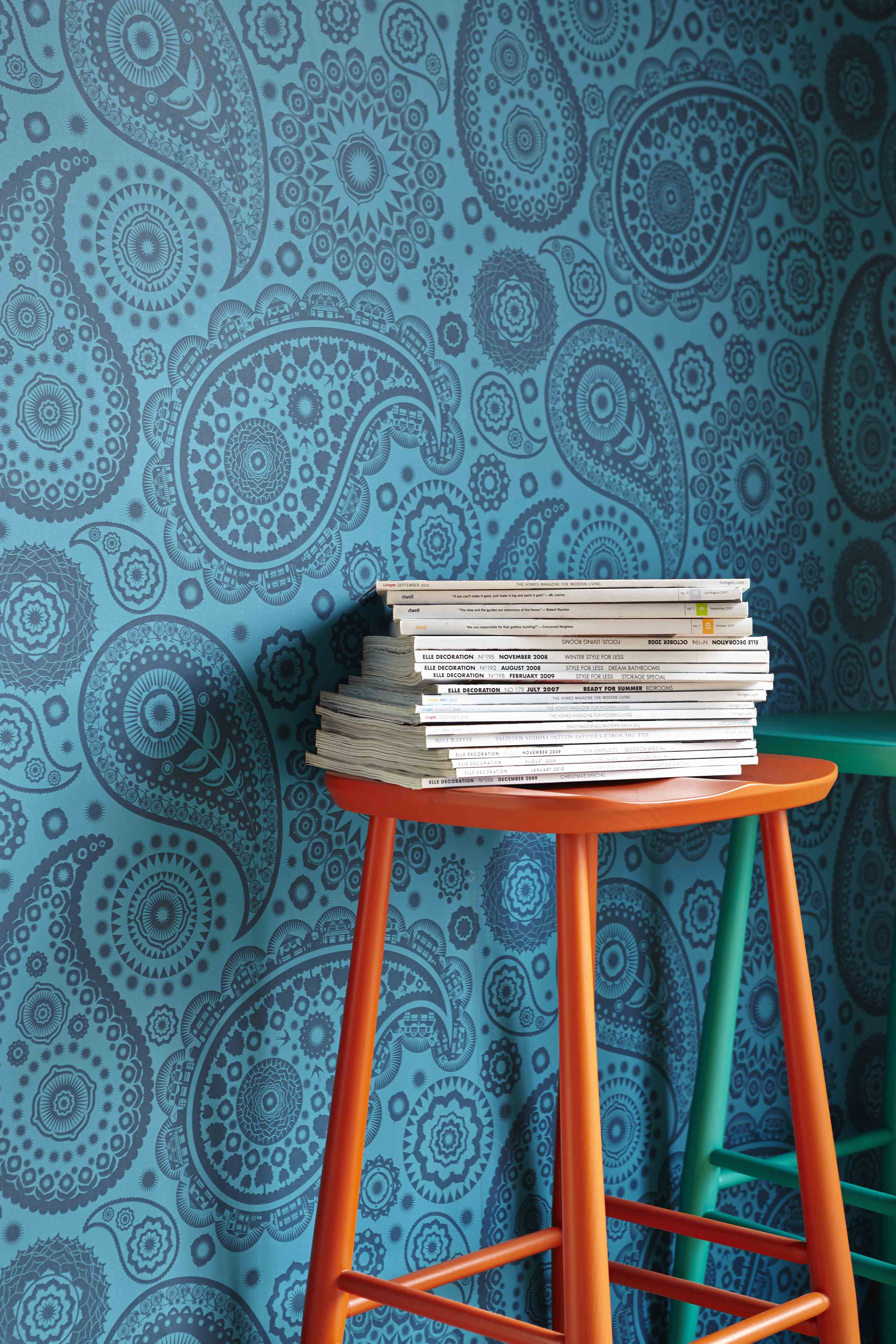 Orange ercol bar stool with blue retro wallpaper. Love that blue ...